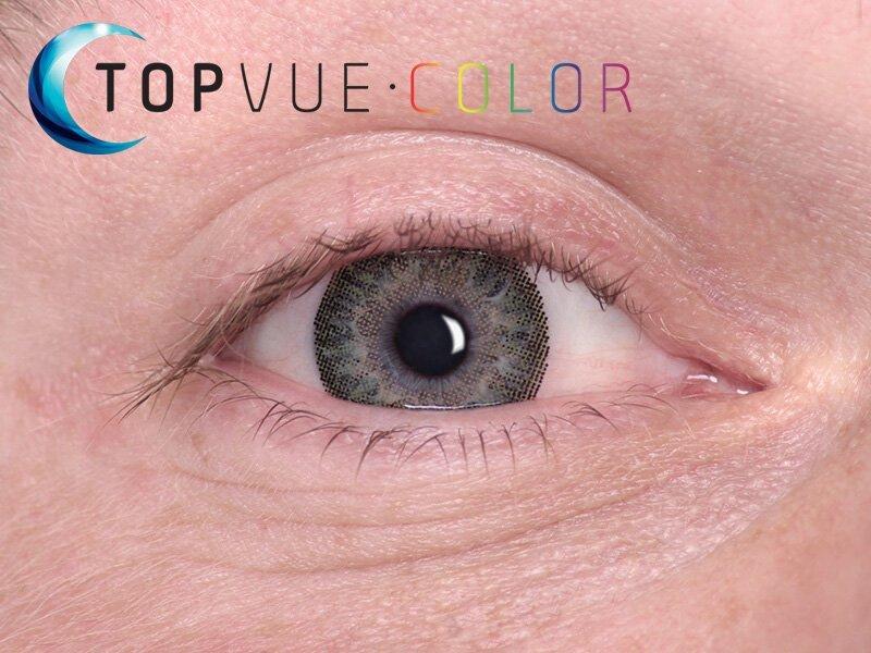 Green na modrém oku