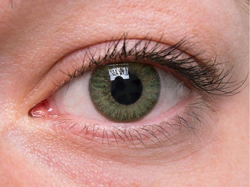 Green na šedém oku